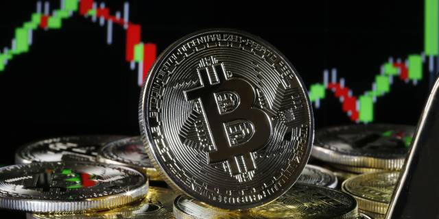 Bitcoin surpasses $50,000 for first time as major companies jump into crypto
